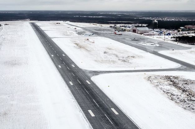 Airport and winter runway aerial view