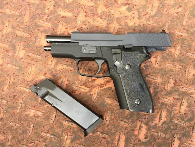 Airsoft 6 mm bullet ball pistol gun on the floor