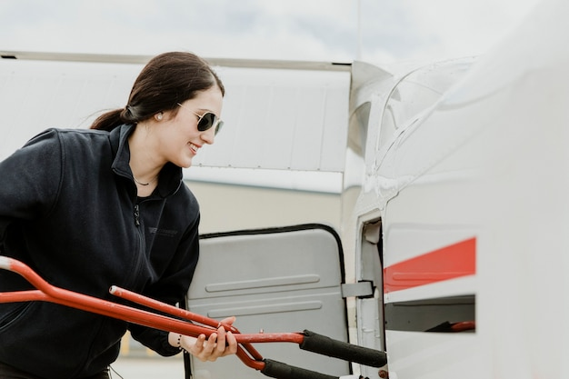 Airwoman holding a tow bar