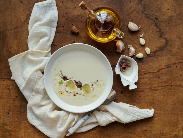 Ajo blanco, spanish typical cold soup, almonds and garlic with olive oil and bread
