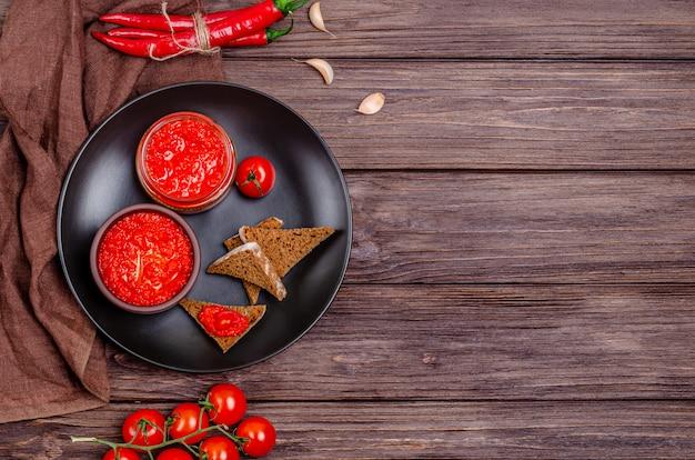 Ajvar or pindjur red vegetable spreaand tomato mousse