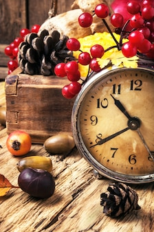 Alarm clock and autumn symbols
