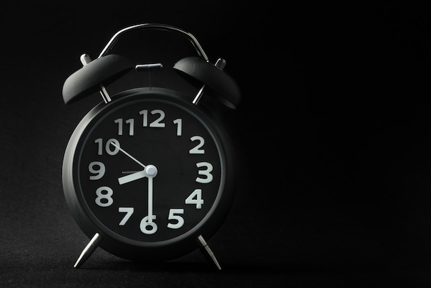 Alarm clock on black background