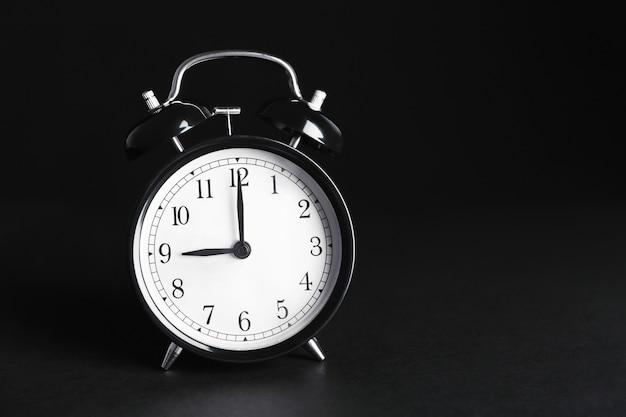 Alarm clock on black