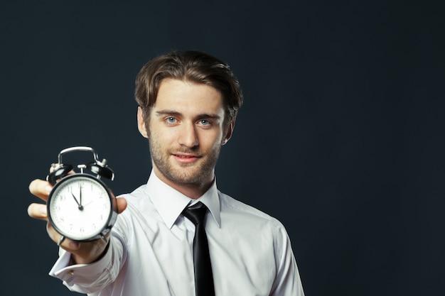 Alarm clock on businessman's hand