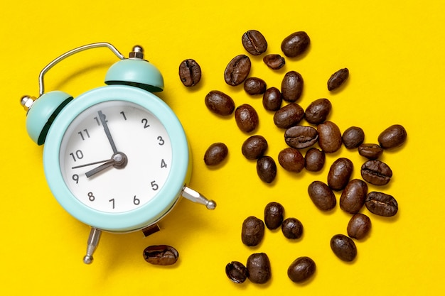 Alarm clock and coffee beans, top view