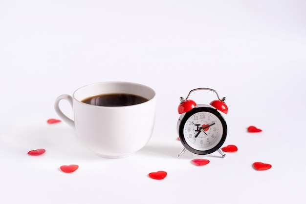 Alarm clock and coffee placed on the table