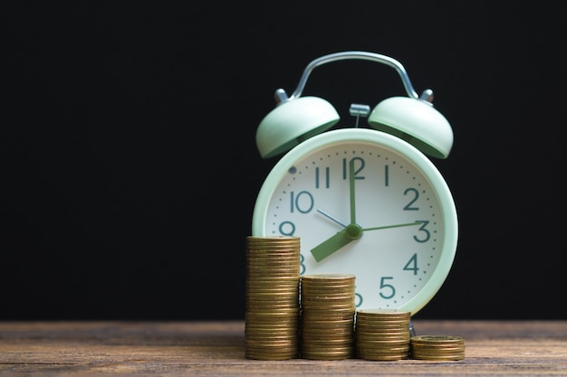 Alarm clock and coins stacks