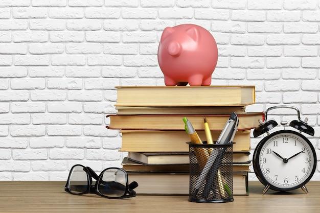 Alarm clock, glasses, piggybank and books