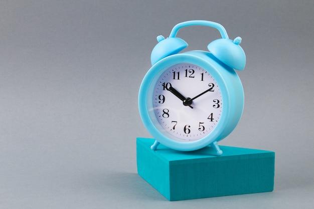 Alarm clock on grey