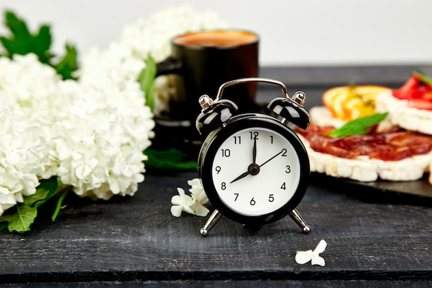 Alarm clock have a good day with a cup of coffee.