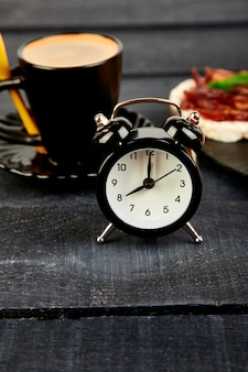 Alarm clock have a good day with a cup of coffee