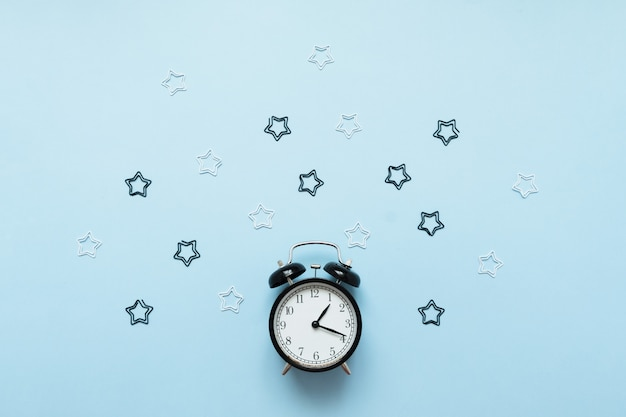 Alarm clock isolated on blue background