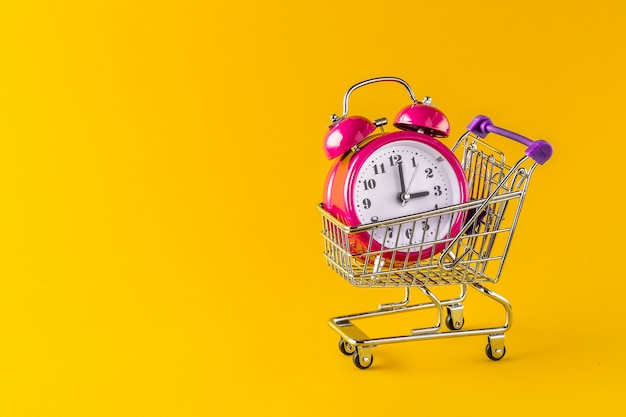 Alarm clock and mini trolley cart with space copy