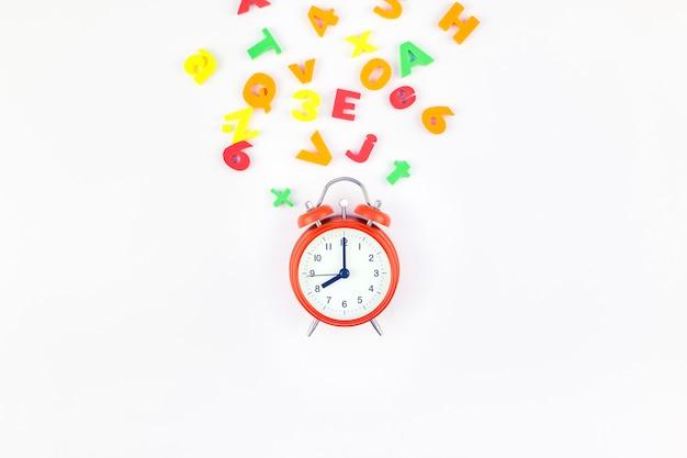 Alarm clock and multicolor alphabet