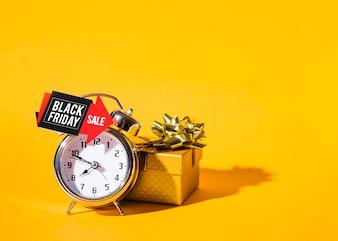 Alarm clock near present box