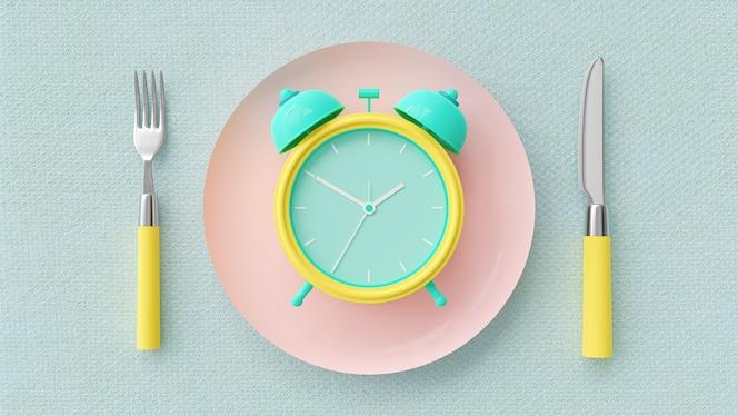Будильник на розовой пастельной тарелке.