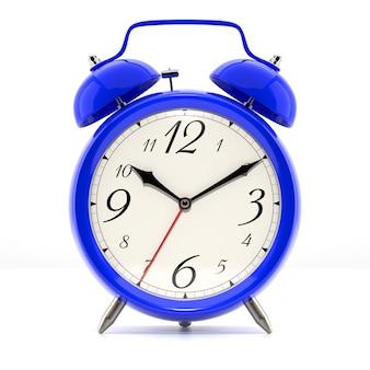 白い背景の上の目覚まし時計