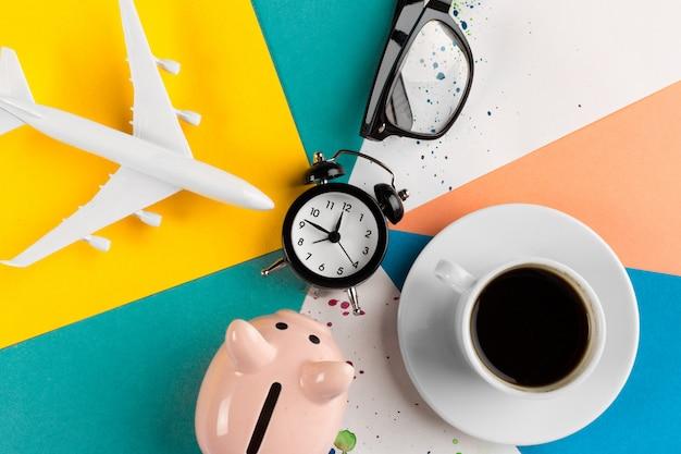 Alarm clock and piggy bank concept for saving time