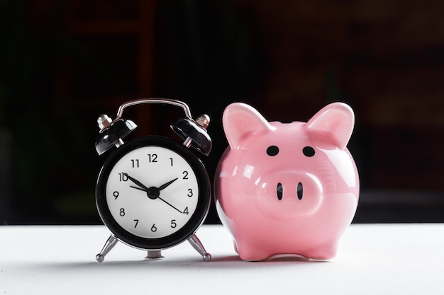 Alarm clock and piggy bank  for saving time