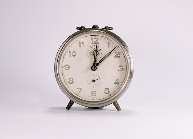 Alarm clock retro and vintage classic design in white background