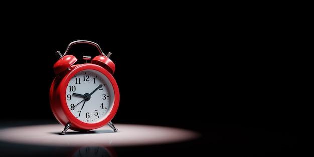 Alarm clock in the spotlight isolated