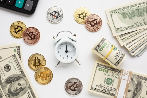 Alarm clock surrounded by currency