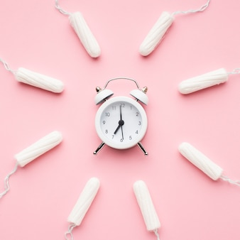 Alarm clock surrounded by tampons