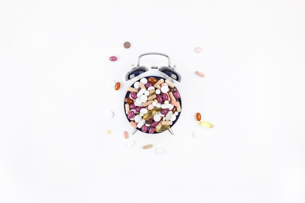 Alarm clock with color pills