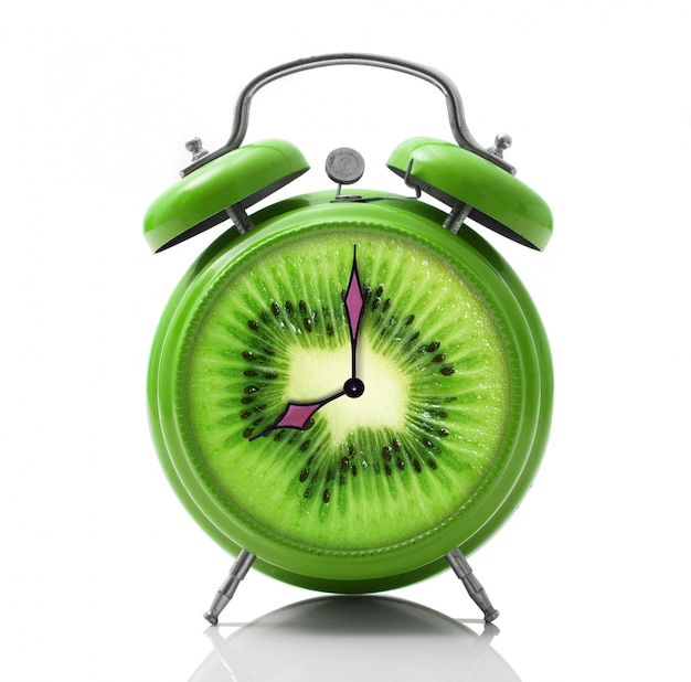 Alarm clock with kiwi dial on white