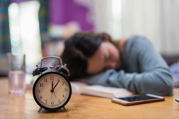 Alarm clock with sleep student background