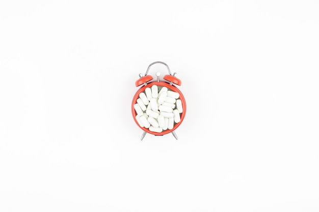 Alarm clock with white pills