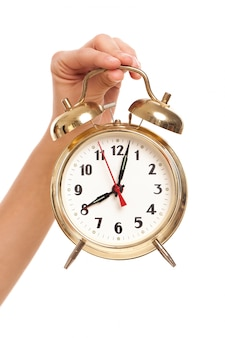 Alarm clock in woman's hand