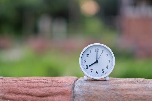 Alarm clock on wood