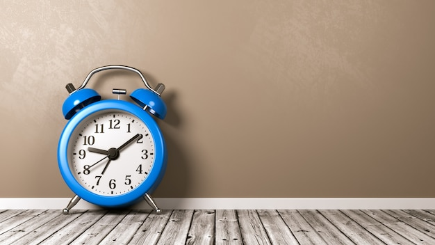 Alarm clock on wooden floor against wall