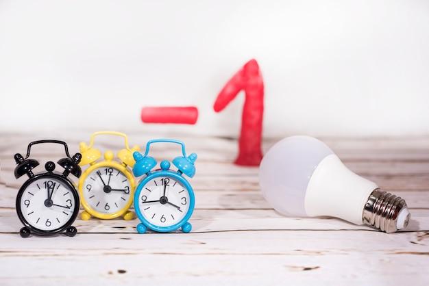 Alarm clocks, number minus one and lightbulb
