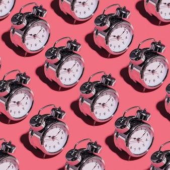 Alarm clocks on pink background