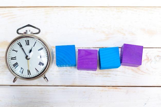 Alarm clocks on wooden table