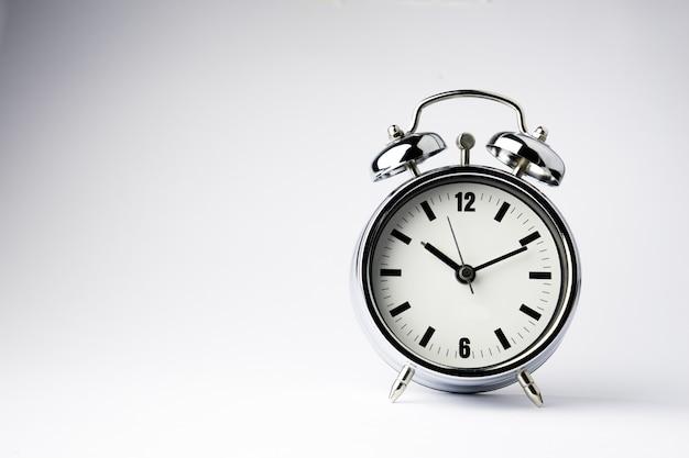 Alarm metal clock on white background