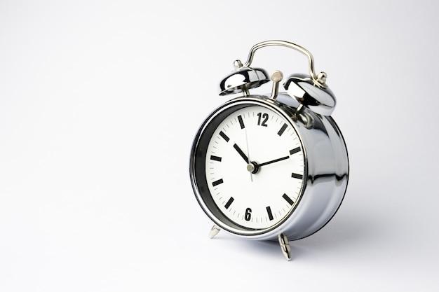 Alarm metal clock on white