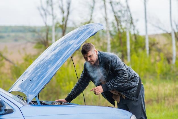 Alarmed driver tries to repair the car