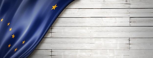 Alaska flag on white wood wall banner, usa. 3d illustration