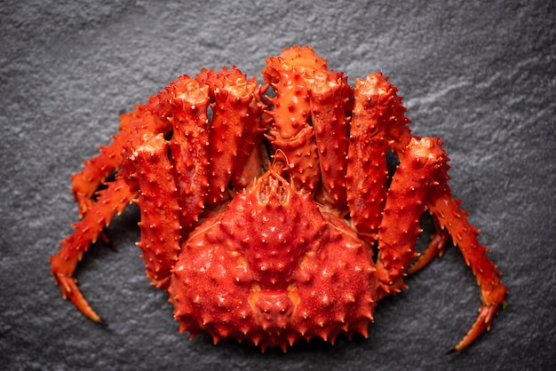 Alaskan king crab cooked steam or boiled seafood on dark / red crab hokkaido