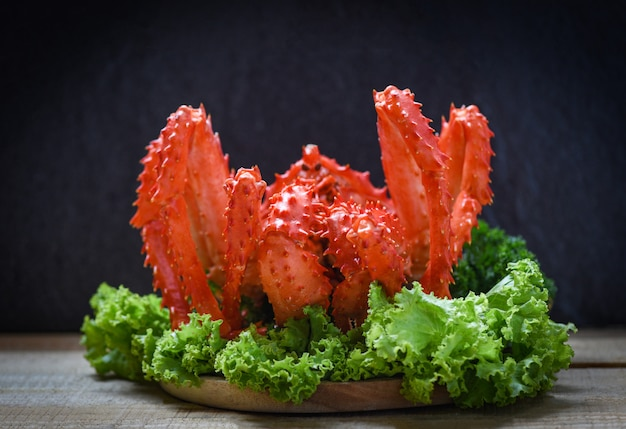 Alaskan king crab cooked steam or boiled seafood and lettuce salad vegetable with dark - red crab hokkaido