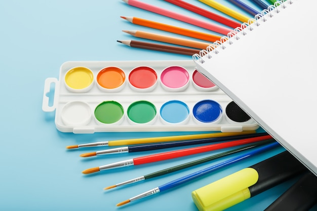 Album for drawing and creativity for school with stationery