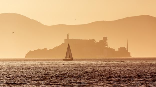 Alcatraz island penitentiary at sunset backlight in san francisco