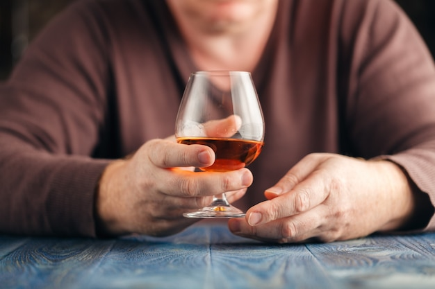 Alcohol abuse, alone man drink whisky for relax