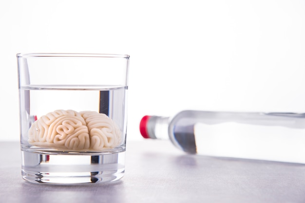 Alcohol addiction concept. brain drowned in alcohol.