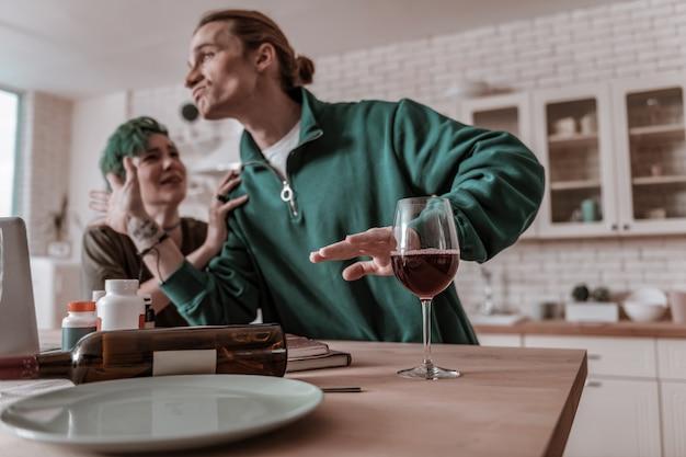 Alcohol addiction. husband feeling emotional and nervous having wife addicted at alcohol