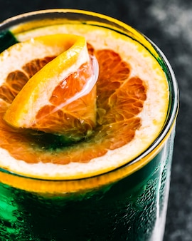 Alcohol cocktail with grapefruit side view